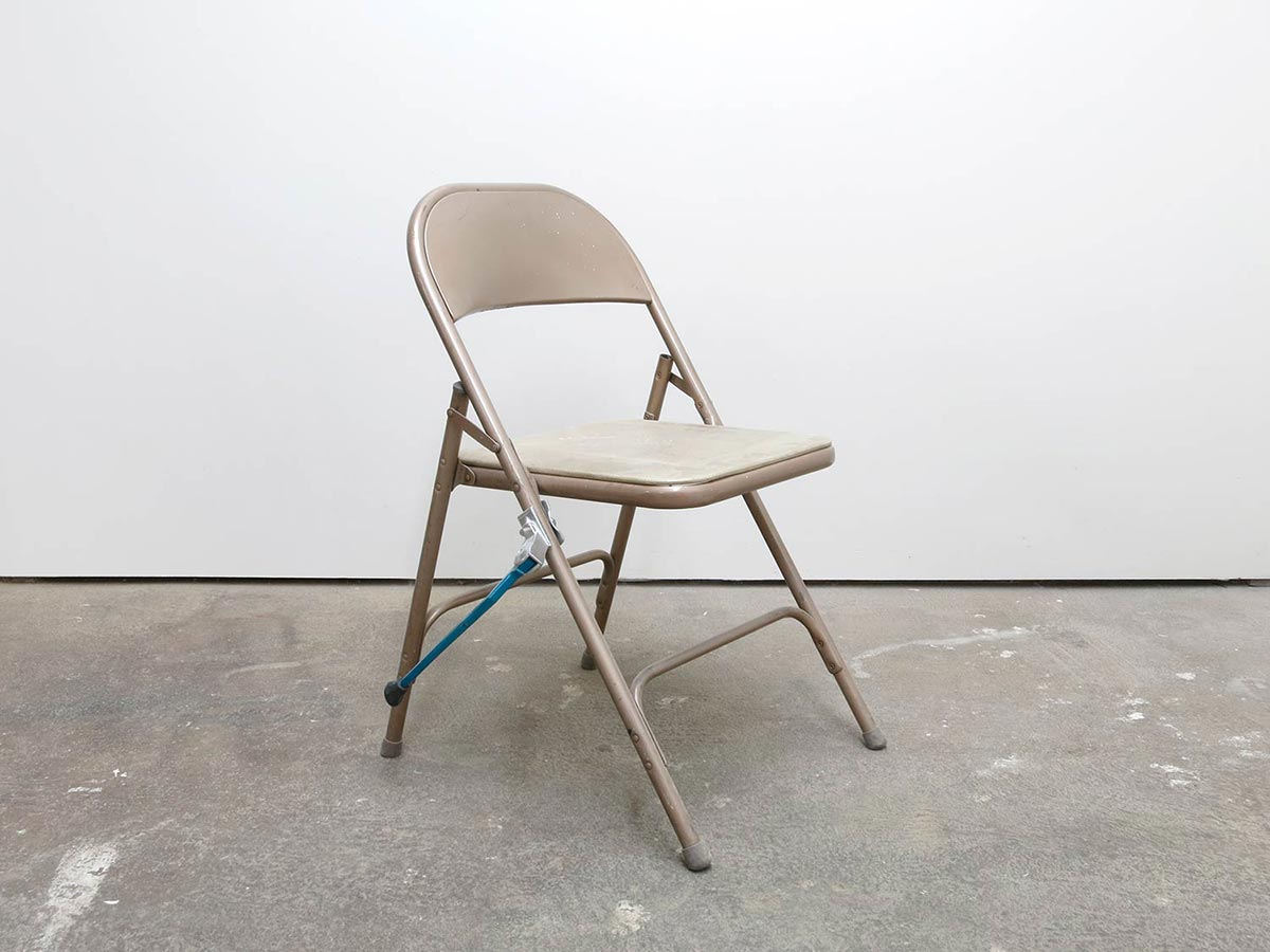 A Sculpture and A Chair